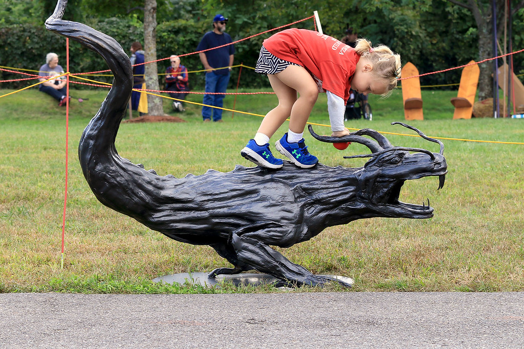 . The 15th annual Blacksmith Art and Renaissance Festival was held on Saturday, September 29, 2018. Eleanor Collins, 4, of Fitchburg plays on the metal dragon at the festival. SENTINEL & ENTERPRISE/JOHN LOVE
