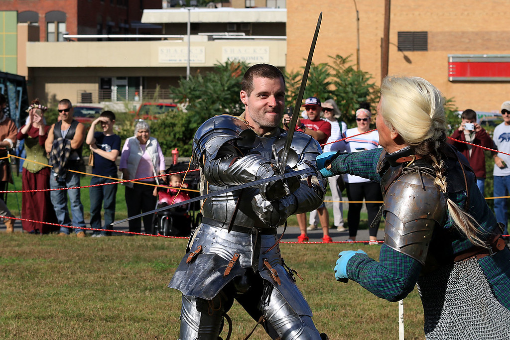 . The 15th annual Blacksmith Art and Renaissance Festival was held on Saturday, September 29, 2018. David Geary of Fitchburg with the Knights of  Lord Talbot sword fights with Krystiana Lett of New Salem with the Iron Clad jousting group during the festival. SENTINEL & ENTERPRISE/JOHN LOVE