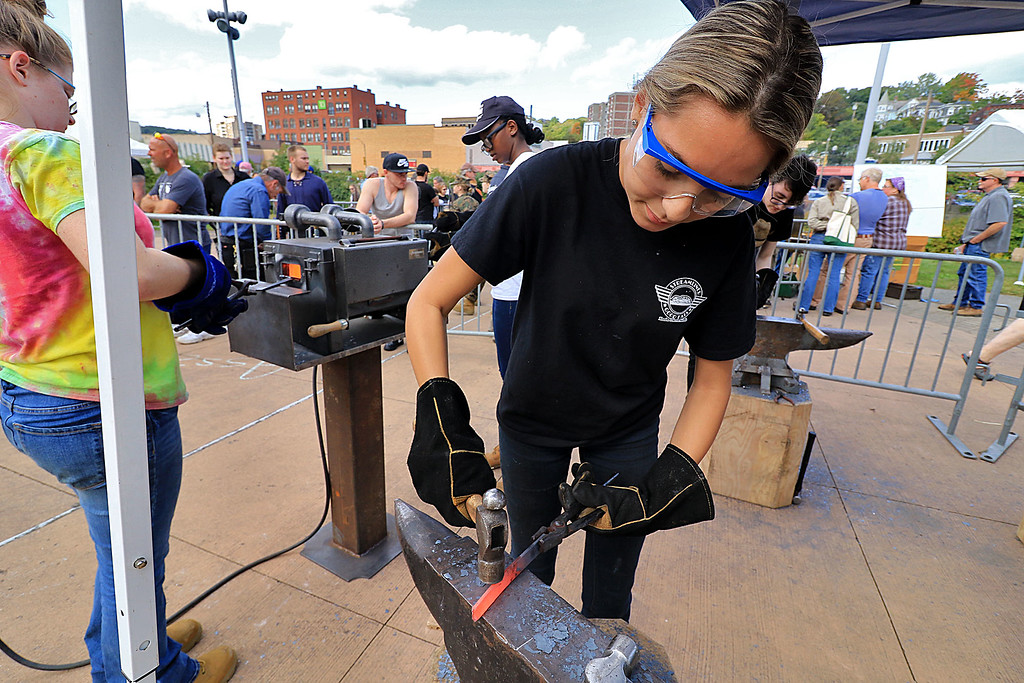 . The 15th annual Blacksmith Art and Renaissance Festival was held on Saturday, September 29, 2018. Brianna Fasulo, 16, from Bristol-Plymouth Regional Technical School molds some heated metal during the festival. SENTINEL & ENTERPRISE/JOHN LOVE