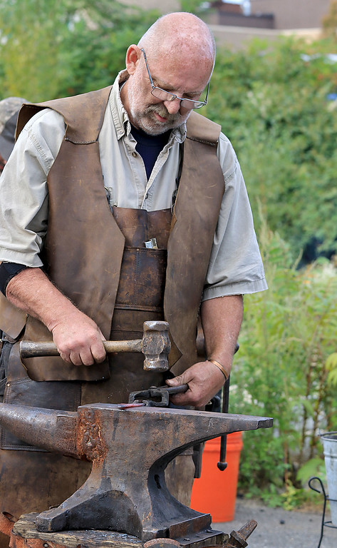 . The 15th annual Blacksmith Art and Renaissance Festival was held on Saturday, September 29, 2018. Blacksmith Dirk Underwood of Hudson molds some heated up metal during the festival. SENTINEL & ENTERPRISE/JOHN LOVE