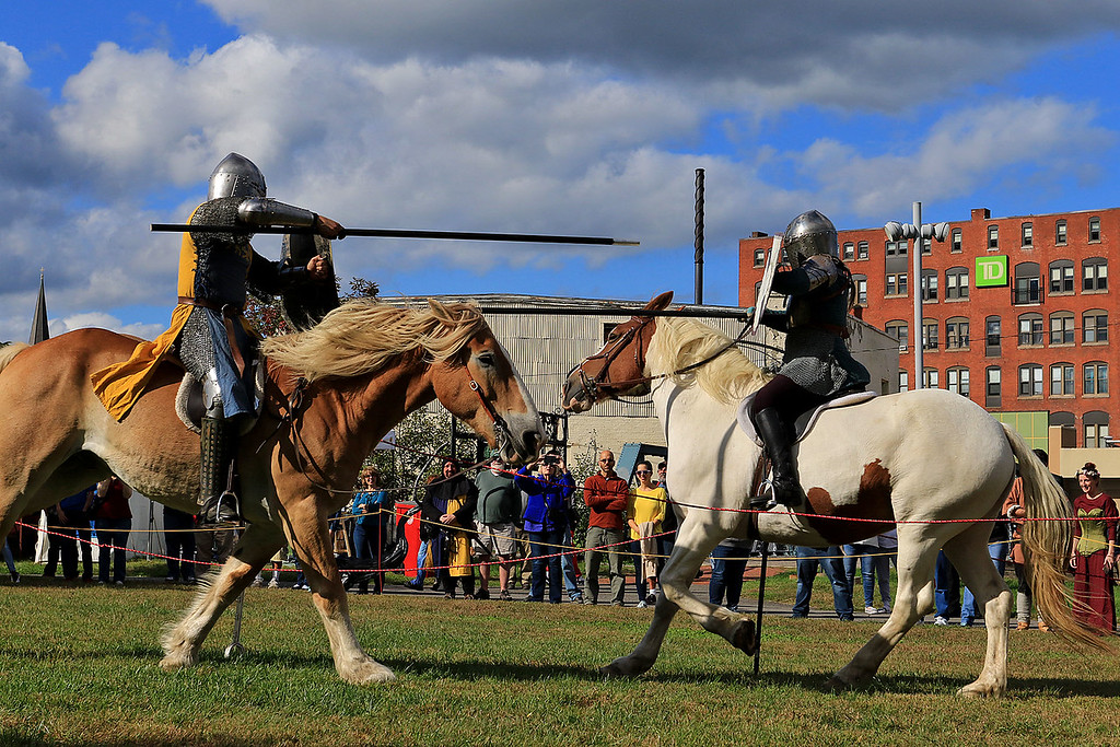 . The 15th annual Blacksmith Art and Renaissance Festival was held on Saturday, September 29, 2018. Cris Lett, on left, of New Salem, on Legato a Belgian horse, jousts with Krystiana Lett, his mom, also from New Salem, on Rosie a Belgian paint horse, during the festival. SENTINEL & ENTERPRISE/JOHN LOVE