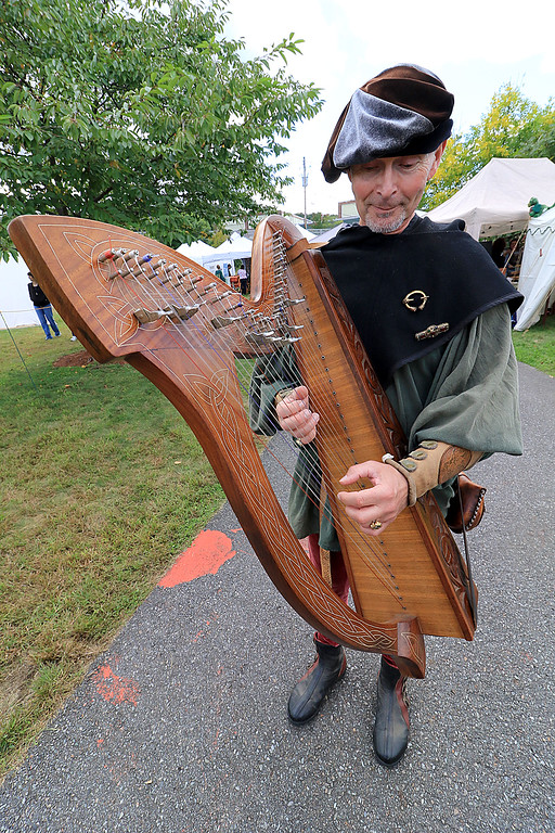 . The 15th annual Blacksmith Art and Renaissance Festival was held on Saturday, September 29, 2018. Guy Todd of Westminster plays the harp as he wonders around the festival dressed the part during the festival. SENTINEL & ENTERPRISE/JOHN LOVE