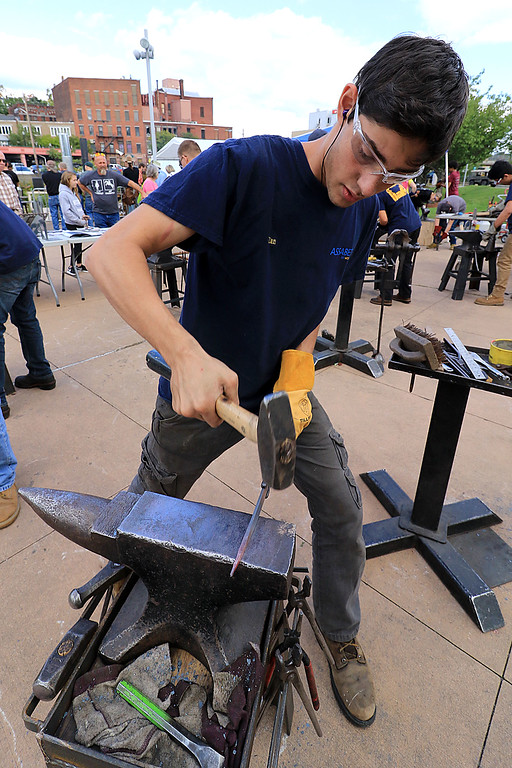 . The 15th annual Blacksmith Art and Renaissance Festival was held on Saturday, September 29, 2018. Elan Cannon, 17, with Assabet Valley Regional Technical High School molds some heated metal during the festival. SENTINEL & ENTERPRISE/JOHN LOVE