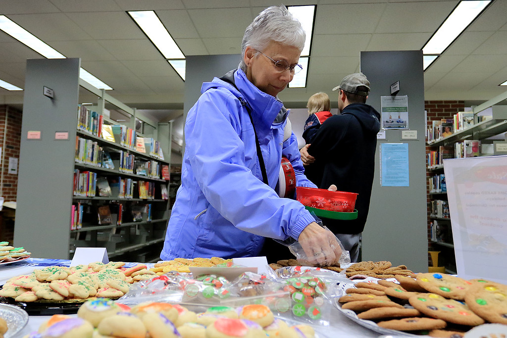 . Holiday Fair and Cookie Sale was held at the Hazen Memorial Library in Shirley on Saturday, November 3, 2018. Polly McGrath of Shirley picks out some cookies to buy during the fair. SENTINEL & ENTERPRISE/JOHN LOVE