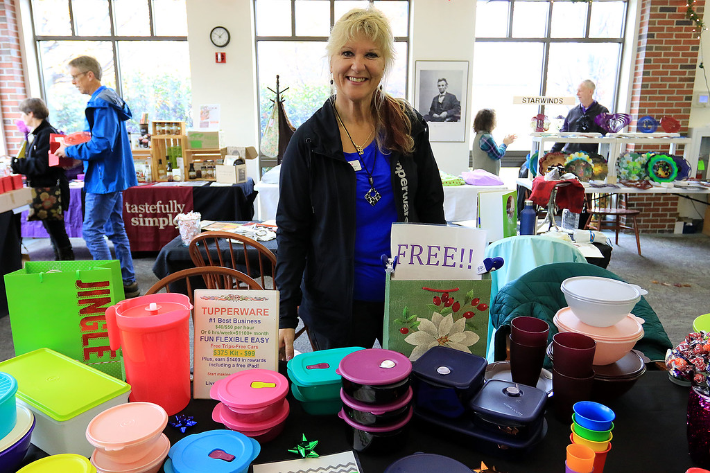 . Holiday Fair and Cookie Sale was held at the Hazen Memorial Library in Shirley on Saturday, November 3, 2018. Brenda Coveno Watson of Fitchburg had a table of Tupper Ware for sale at the fair. The creator of Tupper Ware, Earl Tupper, was from Shirley. SENTINEL & ENTERPRISE/JOHN LOVE