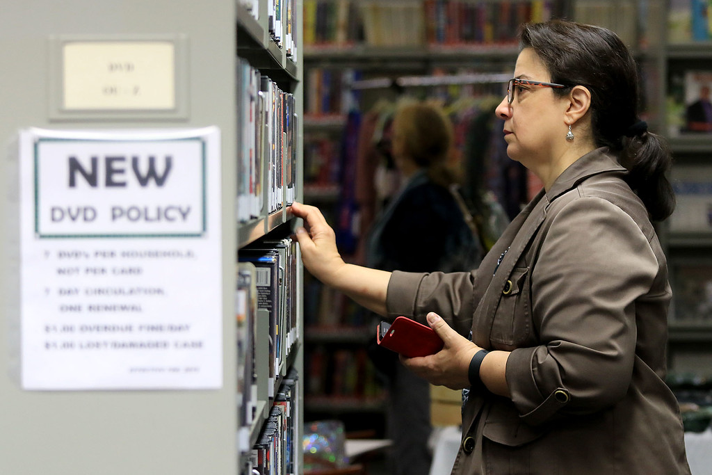 . Holiday Fair and Cookie Sale was held at the Hazen Memorial Library in Shirley on Saturday, November 3, 2018. Lisa Teixeira of Shirley looks for a good book at the library during the fair. SENTINEL & ENTERPRISE/JOHN LOVE