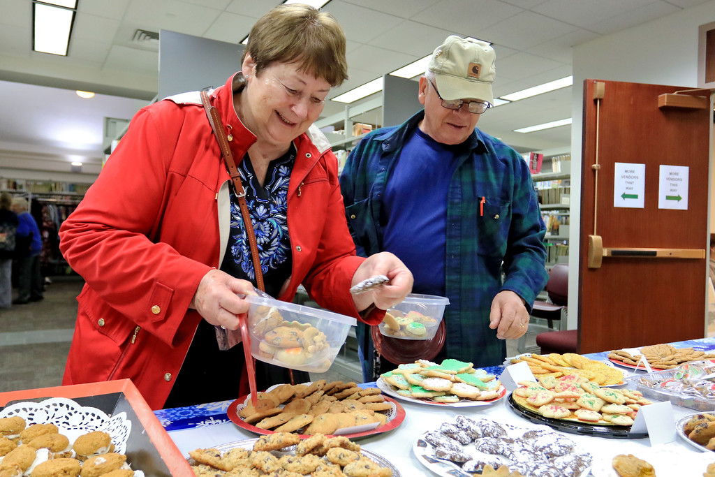 . Holiday Fair and Cookie Sale was held at the Hazen Memorial Library in Shirley on Saturday, November 3, 2018. Marian and John Cardillo of Shirley pick out some cookie to buy during the fair. SENTINEL & ENTERPRISE/JOHN LOVE