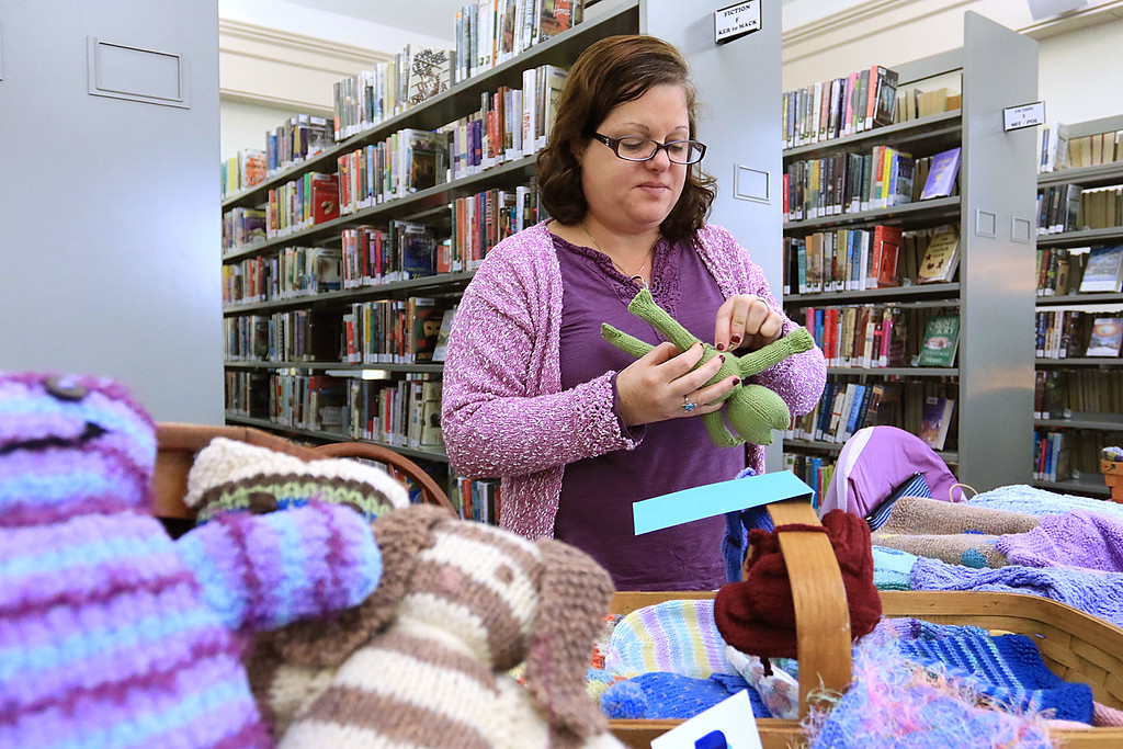 . Holiday Fair and Cookie Sale was held at the Hazen Memorial Library in Shirley on Saturday, November 3, 2018. Liz Petersen of Knits by Liz from Lynn makes a knit frog as she mans her table at the fair. SENTINEL & ENTERPRISE/JOHN LOVE