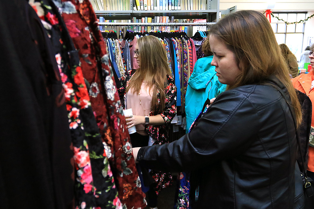 . Holiday Fair and Cookie Sale was held at the Hazen Memorial Library in Shirley on Saturday, November 3, 2018. Elizabeth Ellis of Shirley looks over the dresses from Luloroe from Leominster at the fair. SENTINEL & ENTERPRISE/JOHN LOVE