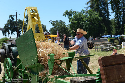 Tim Moss pitches hay into a machine that outputs rectangular bales during the 15th Annual Old Fashioned Country Faire and Threshing Bee on Saturday, June 10, 2017, at the Patrick Ranch Museum in Durham, California. (Dan Reidel -- Enterprise-Record)