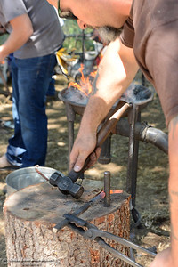 Shawn Casey, of Nelson, bends red-hot metal in the 15th Annual Old Fashioned Country Faire and Threshing Bee on Saturday, June 10, 2017, at the Patrick Ranch Museum in Durham, California. (Dan Reidel -- Enterprise-Record)