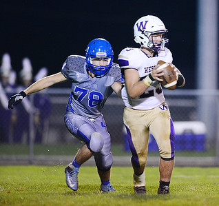Union's Anthony Ryan pressures Western Beaver's quarterback.