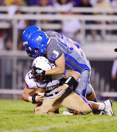 Union's Tim Quigley back and Reno Million front take down a Western Beaver's quarterback.