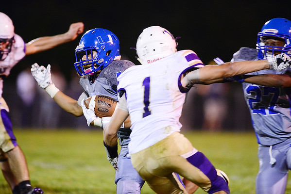 Union's Tre'von Charles runs the ball 55 yards for a touchdown in the second quarter.