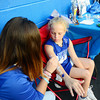 Ten year old Mallory Gorgacz gets her name painted on her arm at the student council fundraiser table by 16 year old Shelby Ligo.