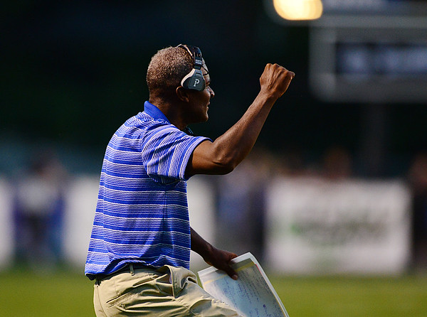 Stacey Robinson, Union's football coach reacts to the first touchdown of the game.