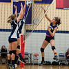 Monty Tech's Marissa Cartier frires a volley against St Bernard's defenders Katherine Bigelow and Morgan Gelinas. SENTINEL&ENTERPRISE/ Jim Marabello