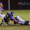 Worcester Tech DB David Carrigan drags down Monty TEch RB Tyler Popp. SENTINEL&ENTERPRISE/ Jim Marabello