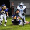 Monty Tech's Tyler Popp (24) pursues Worcester Tech RB Devin Shaw, after he got past MT lineman Travis Hull. SENTINEL&ENTERPRISE/ Jim Marabello