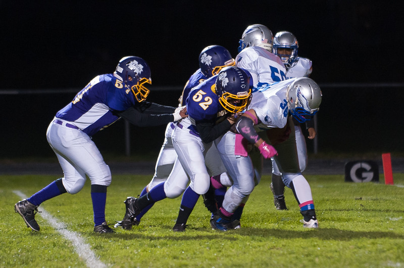 Monty Tech's Sam Satnick (57), AJ Gregson Pareago (52) and Jacob Shepard (rear) all work to bring down Worcster Tech RB David Carrigan. SENTINEL&ENTERPRISE/ Jim Marabello