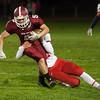 Michael Nowd of FHS is dragged down by North Middlesex defender Joe Haskins. SENTINEL&ENTERPRISE/ Jim Marabello