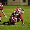 Jake Hachey of North MIddlesex is taken down by CJ Byers of  Fitchburg. SENTINEL&ENTERPRISE/ Jim Marabello