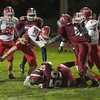North MIddlesex RB Jake Hachey bounces off Fitchburg HS defenders during a run at Crocker Field. SENTINEL&ENTERPRISE/ Jim Marabello