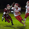 Jake Hachey of North MIddlesex tries to outrun Bruno Correia of Fitchburg. SENTINEL&ENTERPRISE/ Jim Marabello
