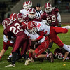 A pile of Fitchburg defenders try to take down Connor Clermont (20) of North Middlesex. SENTINEL&ENTERPRISE/ Jim Marabello