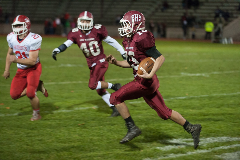 Fitchburg QB Andrew Brooks takes off upfield against North Middlesex. (SENTINEL&ENTERPRISE/ Jim Marabello)