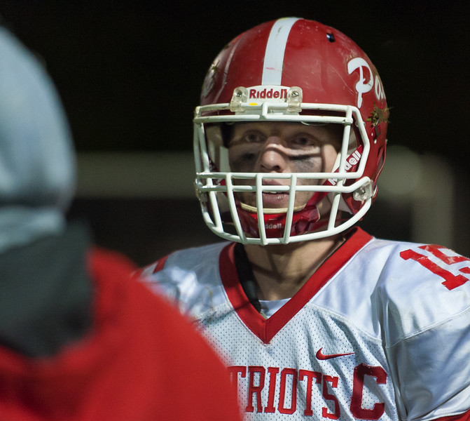 North MIddlesex QB Joe Haskins talks to coaches at the sidelines late in the game against Fitchburg. SENTINEL&ENTERPRISE/ Jim Marabello