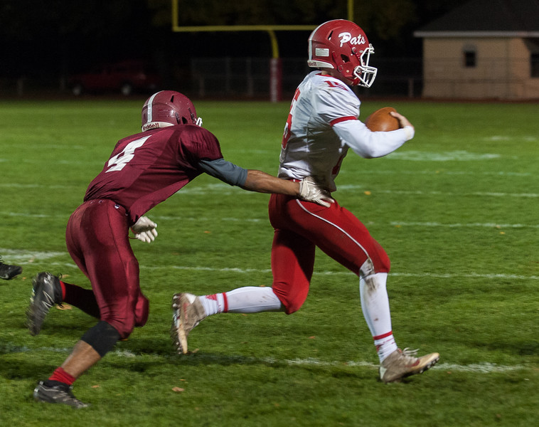 North Middlesex QB Joe Haskins gets by FHS DB Angel Crespo at Crocker Field.  (SENTINEL&ENTERPRISE/ Jim Marabello)