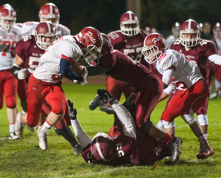 North MIddlesex RB Jake Hachey tries to run through the defense, eluding a tackle by Jaymal Sanchez (59)  and Angel Crespo. (SENTINEL&ENTERPRISE/ Jim Marabello)