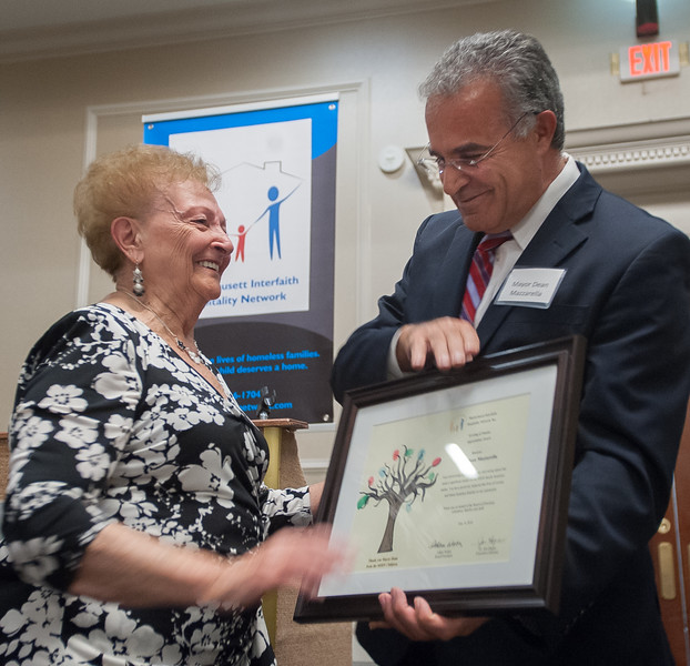 Leominster Mayor Dean Mazzarella brings up his mother Ida as he receives an award during an Evening of Thanks in his honor sponsored by the Montachusett Interfaith Hospitality Network. SENTINEL&ENTERPRISE/ Jim Marabello