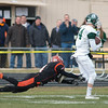Zach Valliere of Gardner makes a shoestring tackle on Oakmont's Evan Bourque to save a touchdown. Oakmont prevailed 26-20 in their Thanksgiving Day Rivalry. SENTINEL & ENTERPRISE / Jim Marabello
