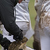 A muddy Oakmont cleat gets cleaned on Thanksgiving Day. The Spartans prevailed 26-20 in their Thanksgiving Classic against Gardner. SENTINEL & ENTERPRISE / Jim Marabello