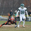 Mud flies as Gardner's Zach Valliere gets tripped up. SENTINEL&ENTERPRISE/ Jim Marabello