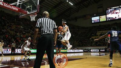 Seth Allen attempts a jump pass towards Zach Leday in the first half. (Mark Umansky/TheKeyPlay.com)