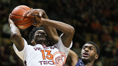 Ahmed Hill is fouled from behind on a shot attempt in the first half. (Mark Umansky/TheKeyPlay.com)