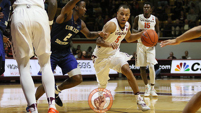 Justin Robinson attempts to dribble past a Charleston Southern defender. (Mark Umansky/TheKeyPlay.com)