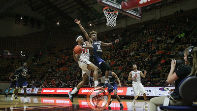 Zach Leday attempts a layup while being heavily guarded. (Mark Umansky/TheKeyPlay.com)