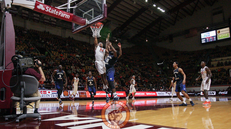 Zach Leday fights off a double team for a dunk in the first half. (Mark Umansky/TheKeyPlay.com)