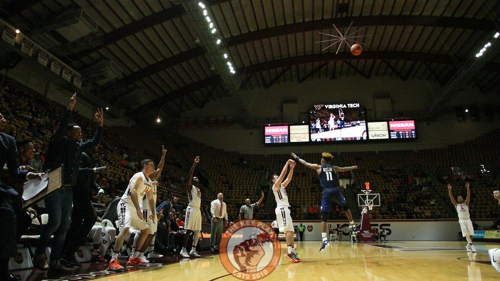 Matt Galloway shoots a three point attempt as the Virginia Tech bench gets ready to celebrate. (Mark Umansky/TheKeyPlay.com)