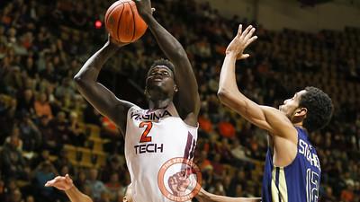 Khadim Sy goes up for a layup underneath the Georgia Tech basket. (Mark Umansky/TheKeyPlay.com)