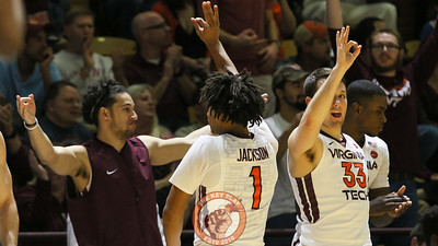 Devin Wilson, Tyrie Jackson, and Matt Galloway celebrate a Virginia Tech three point shot. (Mark Umansky/TheKeyPlay.com)