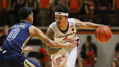 Seth Allen dribbles the basketball in the second half. (Mark Umansky/TheKeyPlay.com)