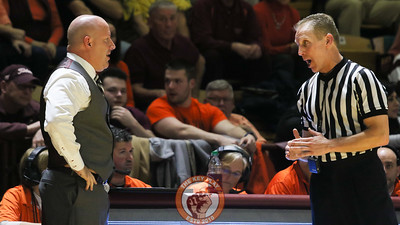 Buzz Williams speaks with the referees after a foul call went against Virginia Tech. (Mark Umansky/TheKeyPlay.com)