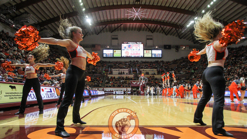 Members of the Virginia Tech High Techs and Cheerleader squads perform for the crowd during a break in the action. (Mark Umansky/TheKeyPlay.com)