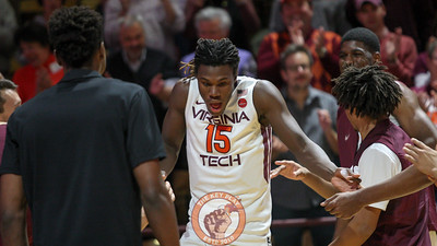 Chris Clarke runs out onto the court during pre-game introductions. (Mark Umansky/TheKeyPlay.com)