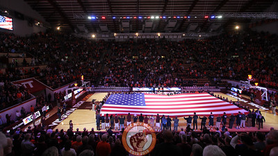A giant-sized American flag is unfurled on the Cassell Collesium court during the national anthem to commemorate Veterans' Day. (Mark Umansky/TheKeyPlay.com)